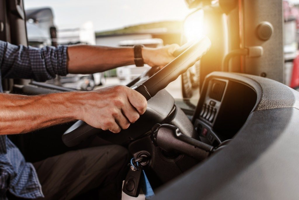 Truck driver holding the steering wheel