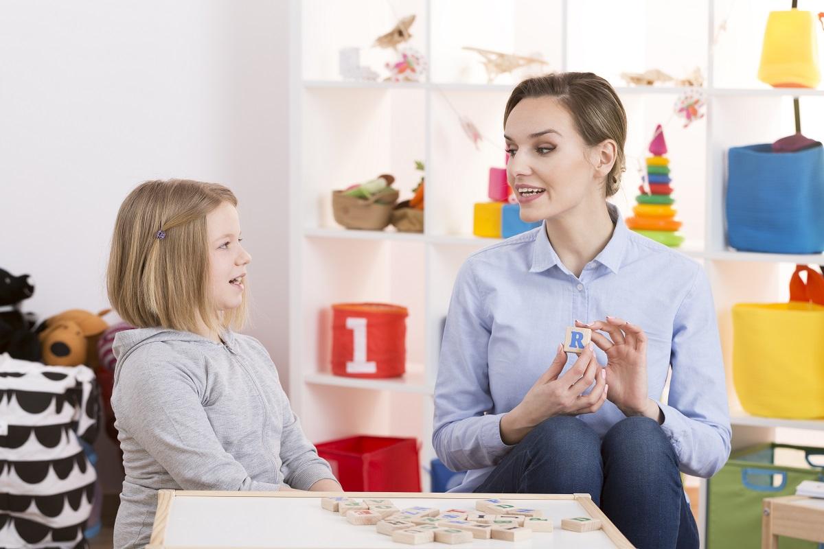 woman teaching a kid