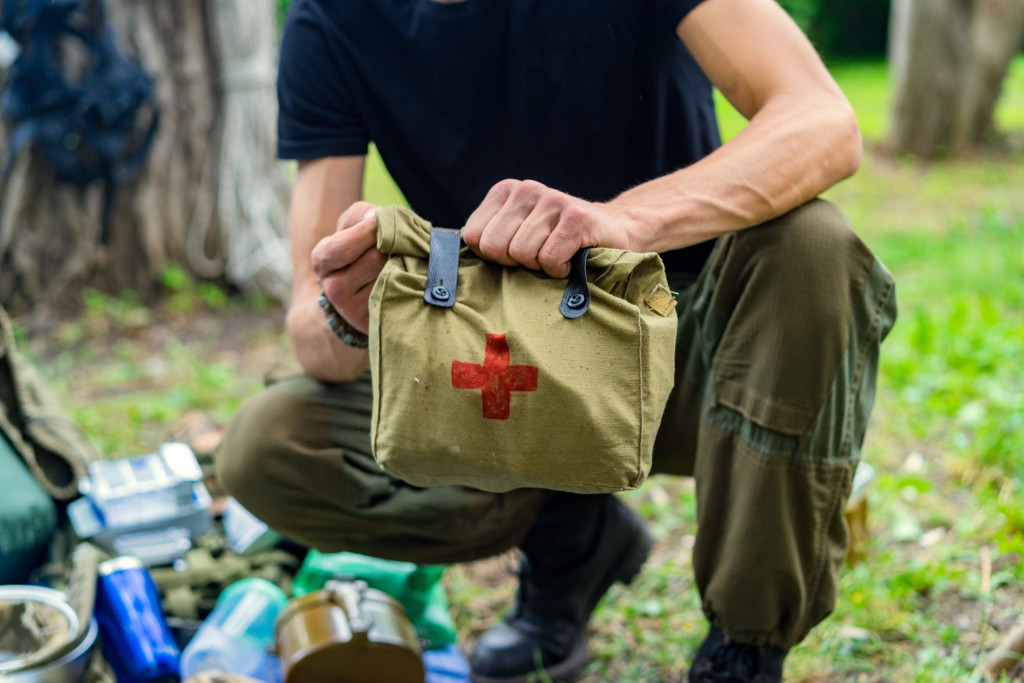 man holding first aid kit